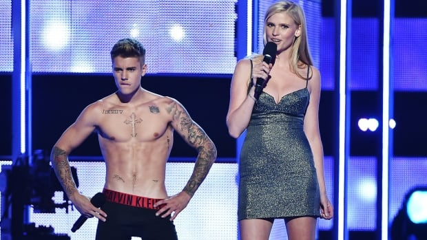 Justin Bieber stripped to his boxers and socks, inspiring screams from the crowd.