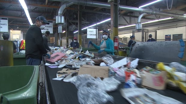 Items at a Montreal recycling plant are sorted. It's estimated that about 15 per cent of things Montrealers put in their recycling bin cannot actually be recycled.