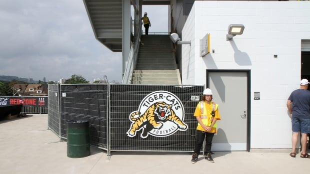 Construction has paused for events at Tim Hortons Field stadium, including Hamilton Tiger-Cats' home games. But it won't be ready to hand over to the city until at least Nov. 28.