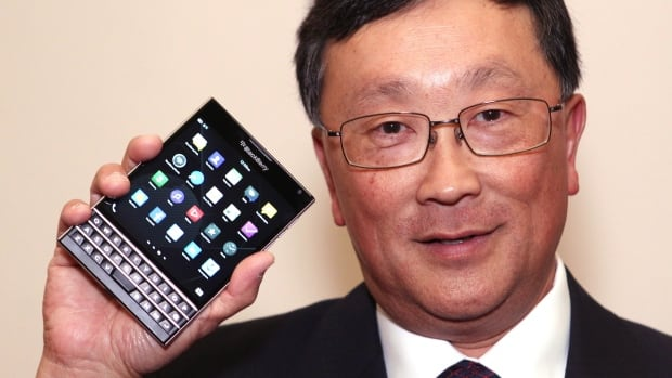 BlackBerry CEO John Chen shows off the new Passport phone at the company's annual meeting June 19. It will come out later this month. Today, BlackBerry bought Movirtu, which allows two numbers on a single phone.