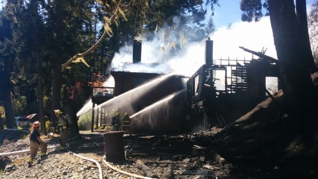 A house near Kemp Lake, west of Sooke, B.C., was destroyed by a fire that started in a shed on the property today, Sept. 11, 2014. The fire susbsequently spread to nearby trees and became a wildfire.