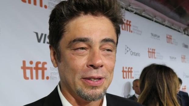 Actor Benicio del Toro speaks to reporters on the red carpet at the 2014 Toronto International Film Festival.