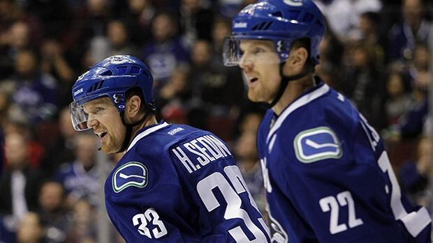 Henrik, left, and Daniel Sedin saw their production fade last season as Vancouver slid out of the playoff picture.