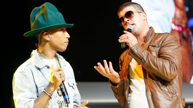 Singer Pharrell Williams, left, and singer Robin Thicke are shown together at the Walmart annual shareholders meeting in Fayetteville, Ark., in June.