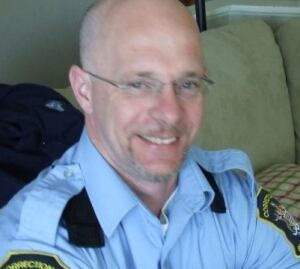 Barry Rhodes, in happier times, employed as a correctional officer