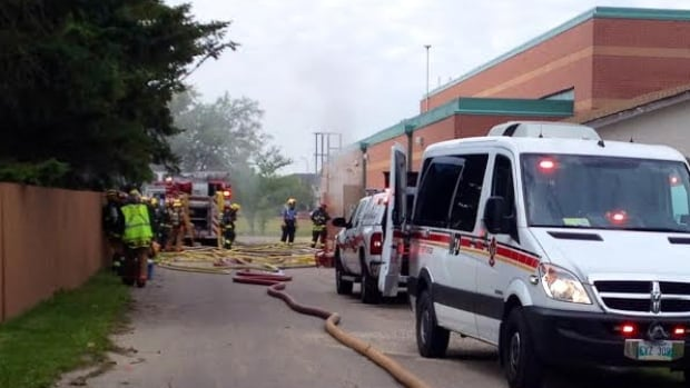 Emergency crews work on putting out a fire at Margaret Grant Pool.