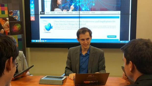 Anatoliy Gruzd sits in Ryerson's Social Media Lab, a space devoted solely to the study of social media.
