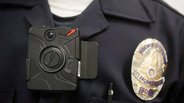 In this Jan. 15, 2014 file photo, a Los Angeles Police officer wears an on-body camera during a demonstration for the media.