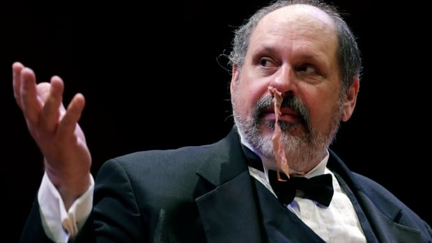 Gary Dryfoos demonstrates the effectiveness of packing strips of cured pork in his nose to stop uncontrollable, life-threatening nosebleeds during a performance at the Ig Nobel Prize ceremony at Harvard University.