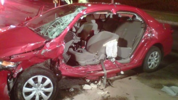 Firefighters tore the driver's side off this Toyota Corolla to get the female driver out after she was trapped for about 40 minutes.