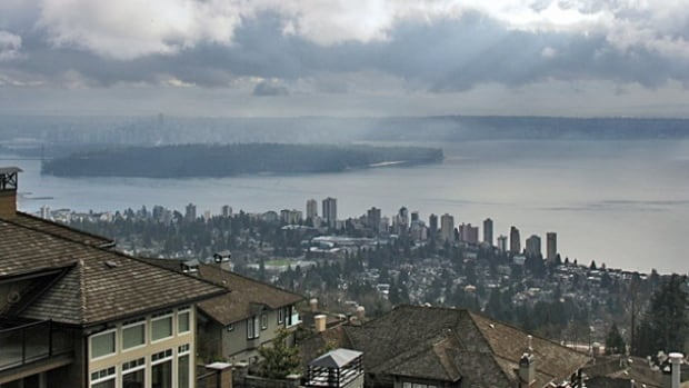 Xu Kuai's West Vancouver home has a stunning view of the ocean, but he says the treetops of his neighbour's house are blocking the view from parts of his house.
