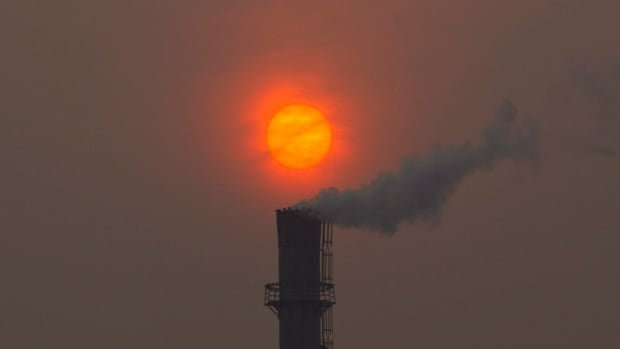 Smoke billows from a chimney of a heating plant as the sun sets in Beijing in a 2012 photo. Chinese emissions grew by 4.2 per cent last year, research ahead of the opening of Climate Week on Monday indicate.