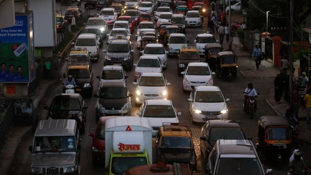 Traffic moves at dusk in Mumbai. As more than 100 world leaders prepare to meet at the UN Climate Summit to discuss how to reverse the emissions trend, doctors say there are health benefits in reducing greenhouse gas emissions.