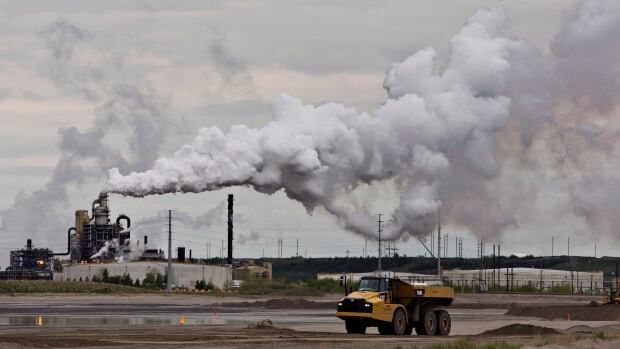 A truck works near the Syncrude oilsands extraction facility near the town of Fort McMurray, Alta., in June 2014.