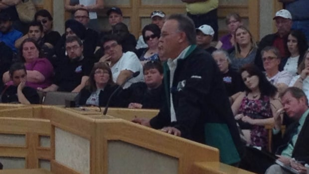 Jim Yakubowski, president of the Amalgamated Transit Union Local 615, speaks at a special city council meeting today.