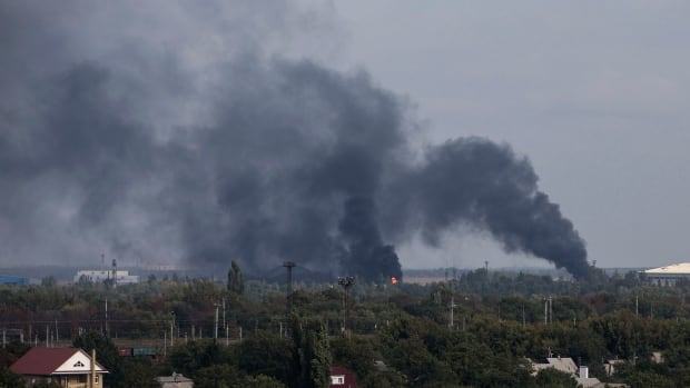 Smoke rises on Tuesday near the Donetsk Sergey Prokofiev International Airport after recent shelling in Donetsk, eastern Ukraine.