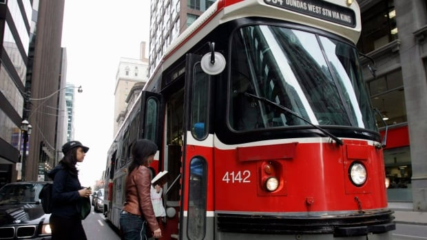 A TTC streetcar takes on passengers.