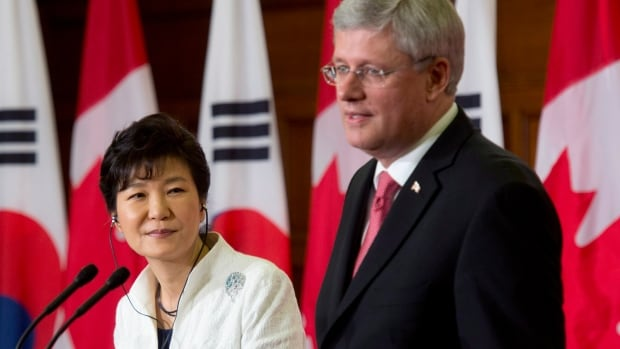 Korean President Park Geun-hye, left, listens to Prime Minister Stephen Harper respond to a question during a joint media availability on Parliament Hill Monday Sept. 22, 2014. The two leaders signed a free-trade agreement.