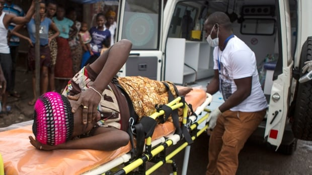 A pregnant woman suspected of contracting Ebola is lifted by stretcher into an ambulance in Freetown, Sierra Leone.The Ebola outbreak, the largest ever, has also hit Liberia and Guinea and is believed to have sickened more than 6,200 people.