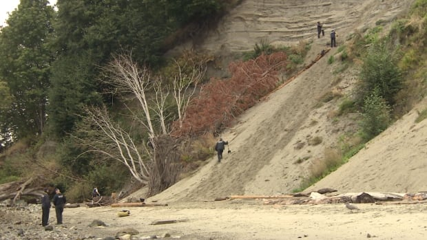 Crews spent the day Thursday digging into the sandy slopes between Tower Beach and Wreck Beach, near Pacific Spirit Park's Trail 4, where the body of a man was discovered Wednesday. Police say the man appears to have been camping above the beach and may have been buried alive sometime in the past week when the clifftop gave way.