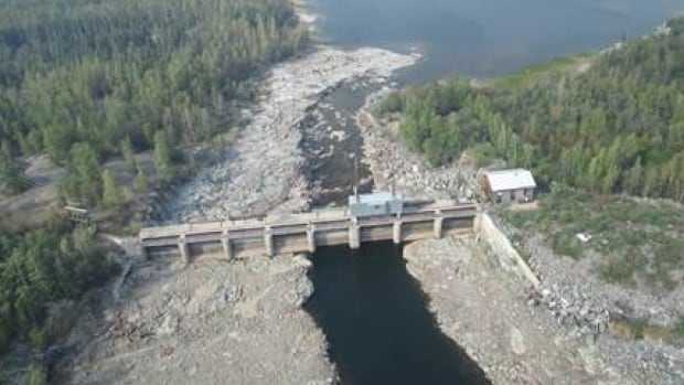 Low water levels in the N.W.T. in the past two years affected the Snare hydro system's electricity output. This photo, taken Aug. 14, 2014, shows low water levels at one of the dams in the Snare system.