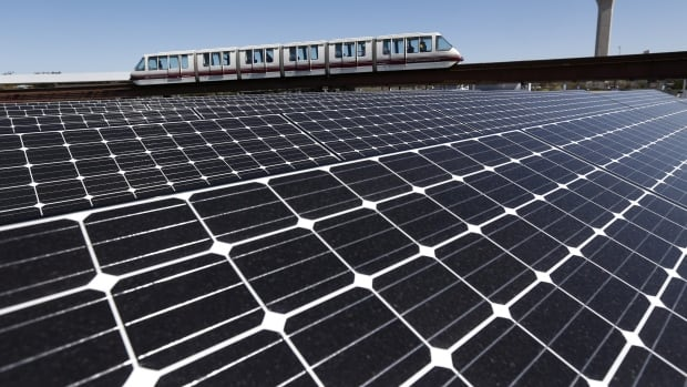 Solar panels supply energy to the AirTrain at Newark Liberty International Airport. A new study finds solar is cost-competitive for peak electricity generation.