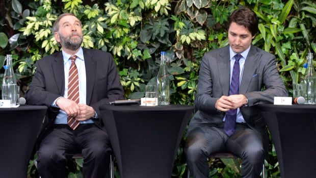 NDP Leader Tom Mulcair, left, and Liberal Leader Justin Trudeau, seen at a panel discussion in Ottawa in March, can both take good news from the decline in support for the Bloc Quebecois in Quebec. But the NDP's strength among francophone voters bodes even better for them.