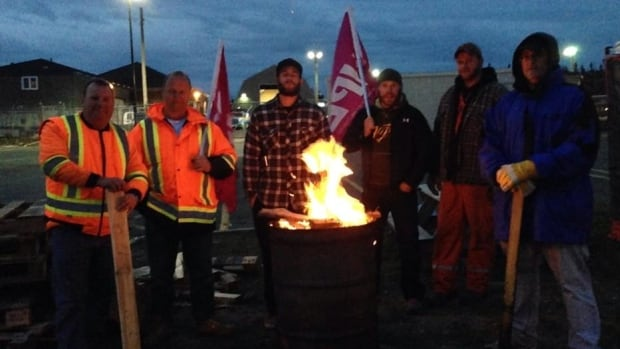 Unionized workers with the City of Mount Pearl set up a picket line outside the city depot after learning CUPE had been locked out.