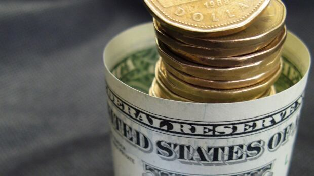 The Canadian dollar is under pressure from both a strong U.S. dollar and falling oil prices.