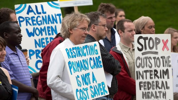 Doctors and other healthcare providers have been protesting the federal government's cuts to refugee health care benefits since 2012. They're back in court Tuesday arguing the federal government isn't complying with a July Federal Court ruling that should have reversed the changes.