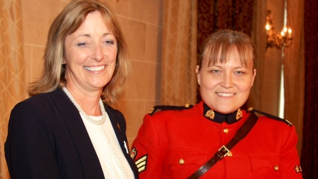 Sgt. Yvonne Niego receives the Community Service Award from Jane Townsley, president of the International Association of Women Police in Winnipeg. Niego is well-known throughout Nunavut, where she's led the campaign for firearm safety in her role as non-commissioned officer in charge of community policing.