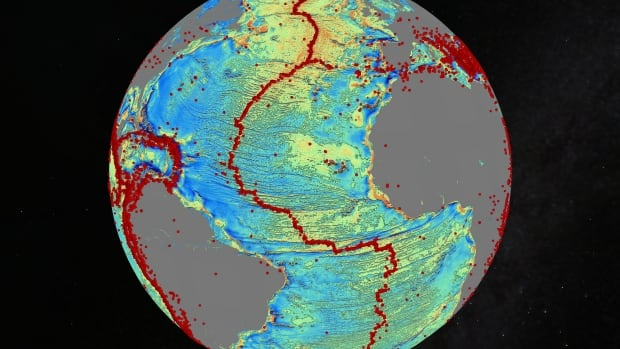 This undersea map of the North Atlantic was generated with gravity data from two satellites. Red dots show locations of  earthquakes with magnitude > 5.5. The maps shows the earthquakes are linked to ridges and faults on the seafloor.