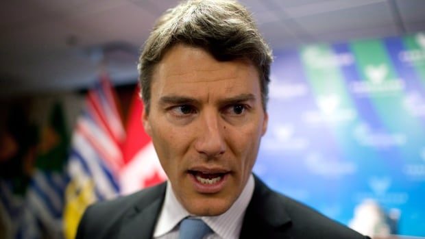 Mayor Gregor Robertson speaks to reporters during a 2013 Vancouver news conference. Robertson is making his fight against Kinder Morgan's oil pipeline expansion a key plank of his re-election campaign.