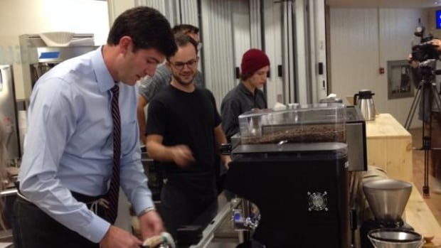 Owner Nate Box looked on as Mayor Don Iveson served coffee during Burrow Cafe's grand opening in October 2014.