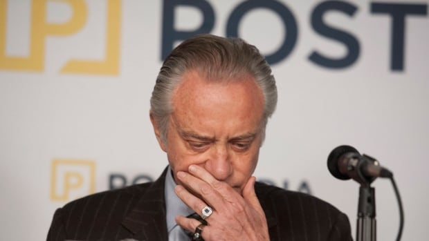 Postmedia President and CEO Paul Godfrey says the company's U.S. denominated debt is a burden.