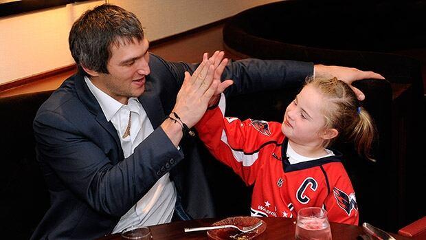 Washington Capitals superstar Alex Ovechkin, left, high fives fan Ann Schaab after their sushi date.
