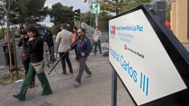 Journalists work on Tuesday at the entrance of the Carlos III  hospital where a Spanish nurse who contracted the Ebola virus is being treated.