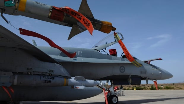 Canadian CF-18s, like the one pictured, will  take part in airstrikes in the Middle East, but CBC News has learned that won't happen for at least three more weeks.