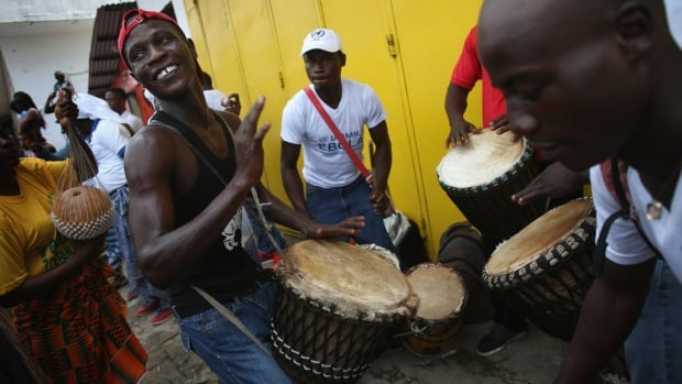 Public health advocates play music to attract people for an Ebola awareness and prevention campaign in Monrovia, Liberia. Musicians are playing a key role in trying to convince residents of the virus's danger and are urging people to wash their hands to stop the spread of the outbreak.