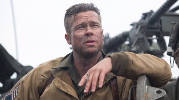 "Brad Pitt stars as Sergeant Don 'Wardaddy' Collins in Fury. The actor says he's ""comfortable"" letting his 13-year-old son, Maddox, see the movie despite its grisly depiction of war battle because he can handle the content."