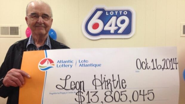 Leon Hirtle poses with his lottery win in Bridgewater on Thursday.