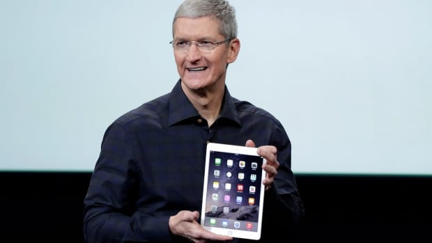 Apple CEO Tim Cook introduced the new Apple iPad Air 2, which is slimmer and faster than its predecessor and has a fingerprint sensor.