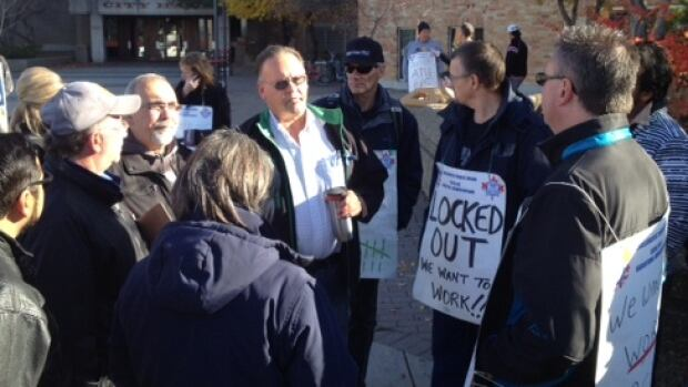 ATU president Jim Yakubowski talks with locked out Saskatoon Transit workers in front of city hall in October 2014.