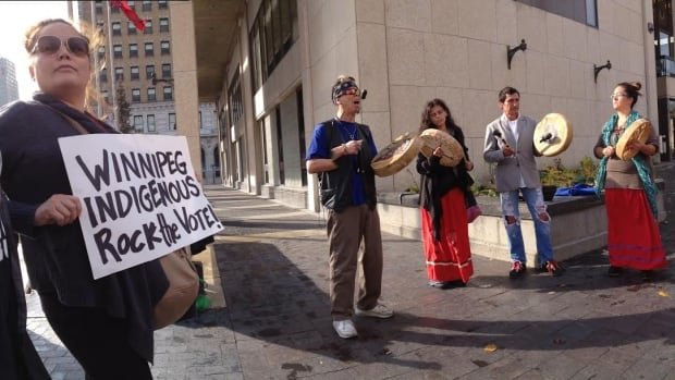 People from Winnipeg Indigenous Rock the Vote, a non-partisan group, encourage aboriginal people to cast their ballots.