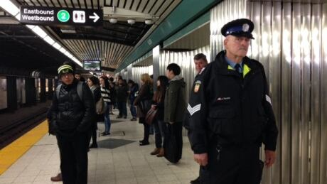 A security officer stands Bloor station