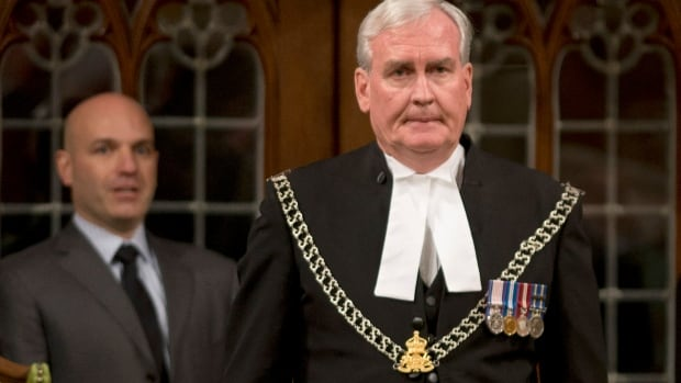 House of Commons Sergeant-at-Arms Kevin Vickers, right, received a long standing ovation from MPs on Oct. 23 in Ottawa. Vickers will be honoured by the Israeli Knesset on Wednesday.
