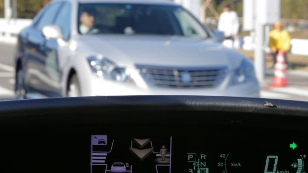 A dashboard display notifies the driver of a pedestrian's presence and an approaching car at the coming intersection during a demonstration of Toyota Motor Corp.'s Intelligent Transport System in 2012. Collision avoidance systems, including some that apply brakes automatically, are increasingly being built into cars, and could potentially be hijacked by hackers.