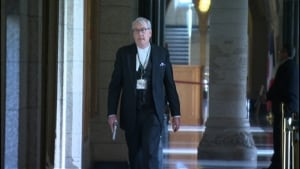 Sgt at Arms Kevin Vickers screen grab from video with gun drawn