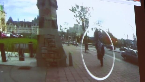 Michael Zehaf-Bibeau is shown carrying a gun while running towards Parliament Hill in Ottawa on Wednesday, in a still taken from video surveillance in this handout photo.