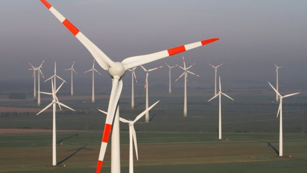 Wind turbines produce green energy in Nauen near Berlin, Germany. The EU has agreed to a 40 per cent reduction in greenhouse gas emissions.
